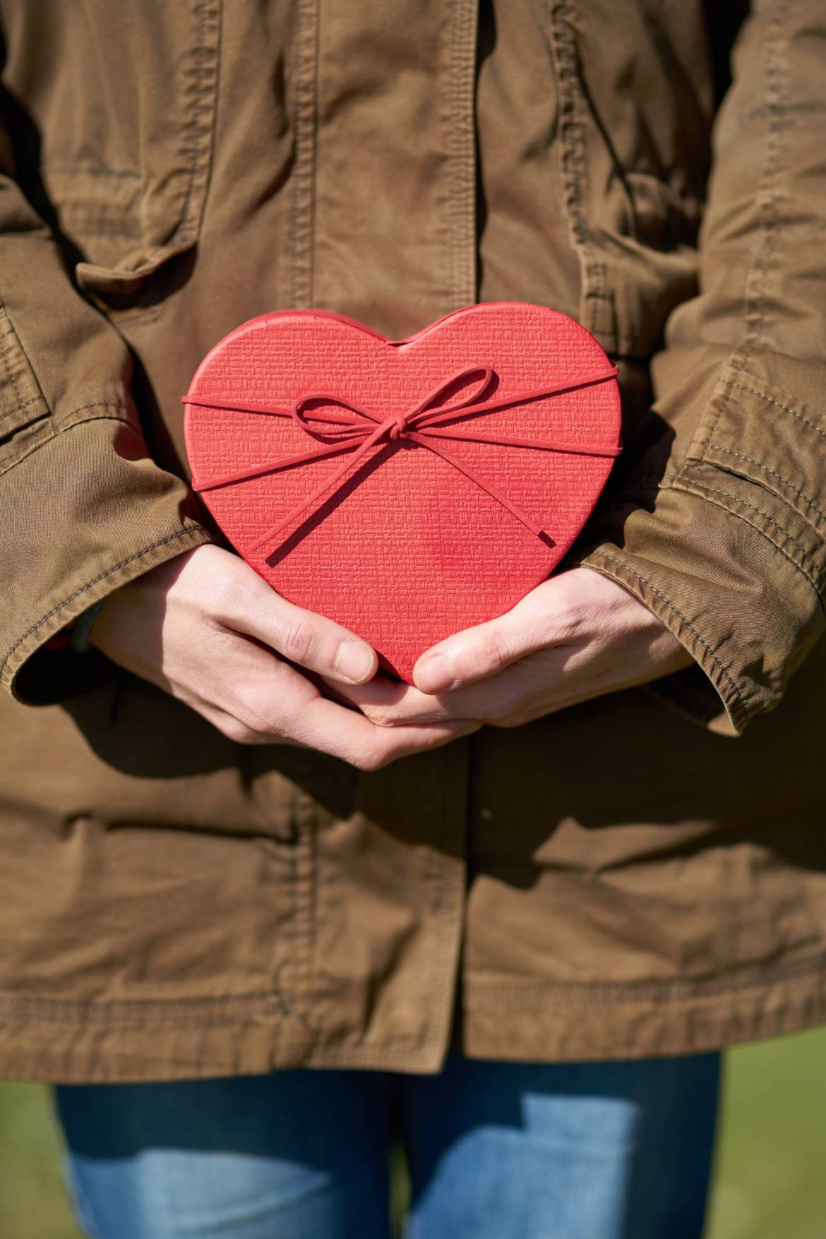person-holding-heart-shaped-gift-1820503.jpg