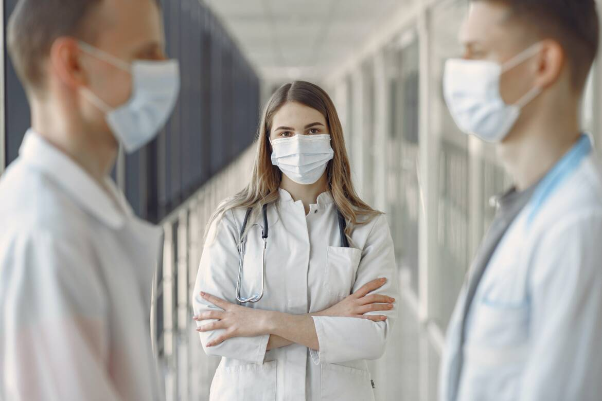 woman-in-white-coat-wearing-white-face-mask-3985163.jpg