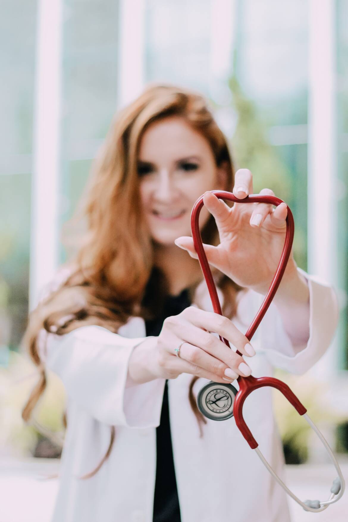 photo-of-woman-holding-red-stethoscope-3408368.jpg